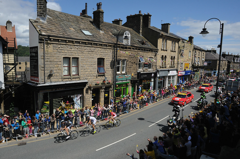 . ILKLEY, UNITED KINGDOM - JULY 05:  Race leaders in the Tour de France ride through the centre of town on Stage 1 of the race on July 5, 2014 in Ilkley, United Kingdom. The world\'s greatest cycle race, the Tour de France started for the first time in its history in Yorkshire this weekend. The event is expected to bring thousands of cycling fans to the region.  (Photo by Ian Forsyth/Getty Images)