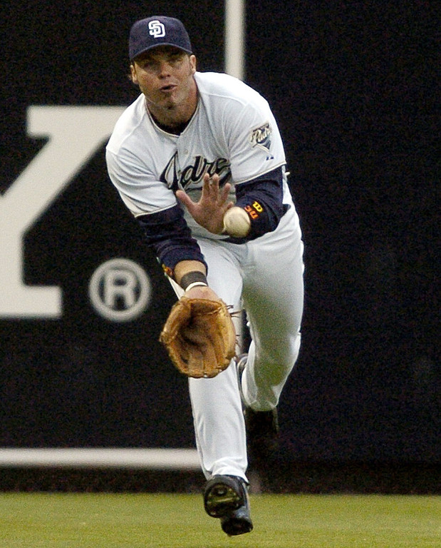 . RYAN KLESKO -- San Diego Padres left fielder Ryan Klesko tries to make the catch on a ball hit by Tampa Bay Devil Rays\' Carl Crawford during the first inning on June 17, 2004, in San Diego. (AP Photo/Denis Poroy)