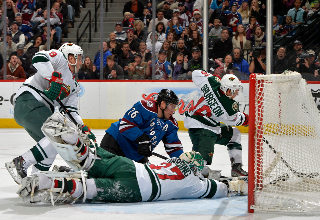 . Minnesota Wild goalie Josh Harding (37), and Jared Spurgeon (46) block a shot on-goal by Colorado Avalanche center Paul Stastny (26) as Wild center Mikko Koivu (9), from Finland, looks on during the first period of an NHL hockey game on Saturday, Nov. 30, 2013, in Denver. (AP Photo/Jack Dempsey)