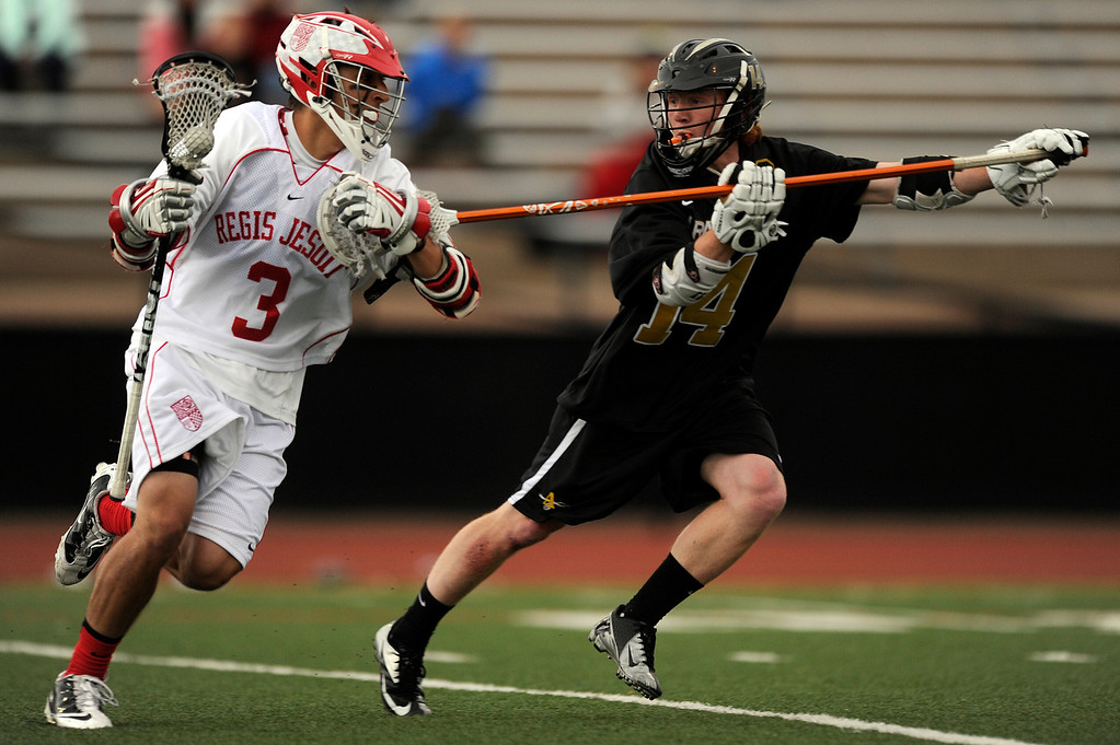 . DENVER, CO - MAY 15: Regis Jesuit junior midfielder Aaron Horvat #3 carries the ball against Arapahoe senior longstick midfielder J D Hall #14 during a CHSAA 5A boys lacrosse semifinal game on May 15, 2013, in Denver, Colorado. Arapahoe won 13-5 to advance to the finals. (Photo by Daniel Petty/The Denver Post)