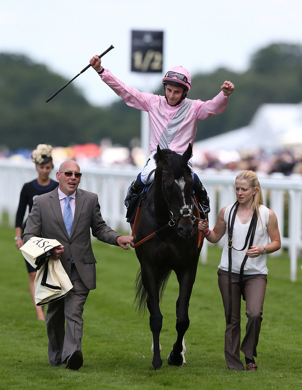 . William Buick riding The Fugue celebrates his victory in the Prince of Wales\'s Stakes on day two of Royal Ascot at Ascot Racecourse on June 18, 2014 in Ascot, England. (Photo by Steve Bardens/Getty Images)