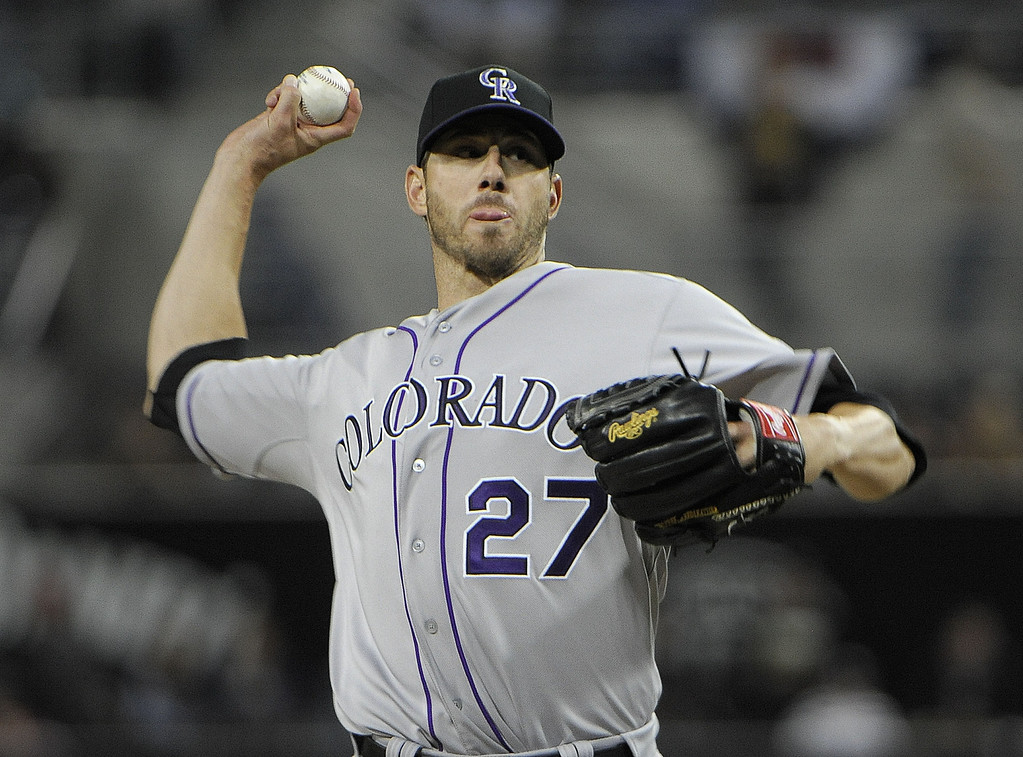 . SAN DIEGO, CA - APRIL 12:  Jon Garland #27 of the Colorado Rockies pitches in the first inning against the San Diego Padres at Petco Park on April 12, 2013 in San Diego, California.  (Photo by Denis Poroy/Getty Images)