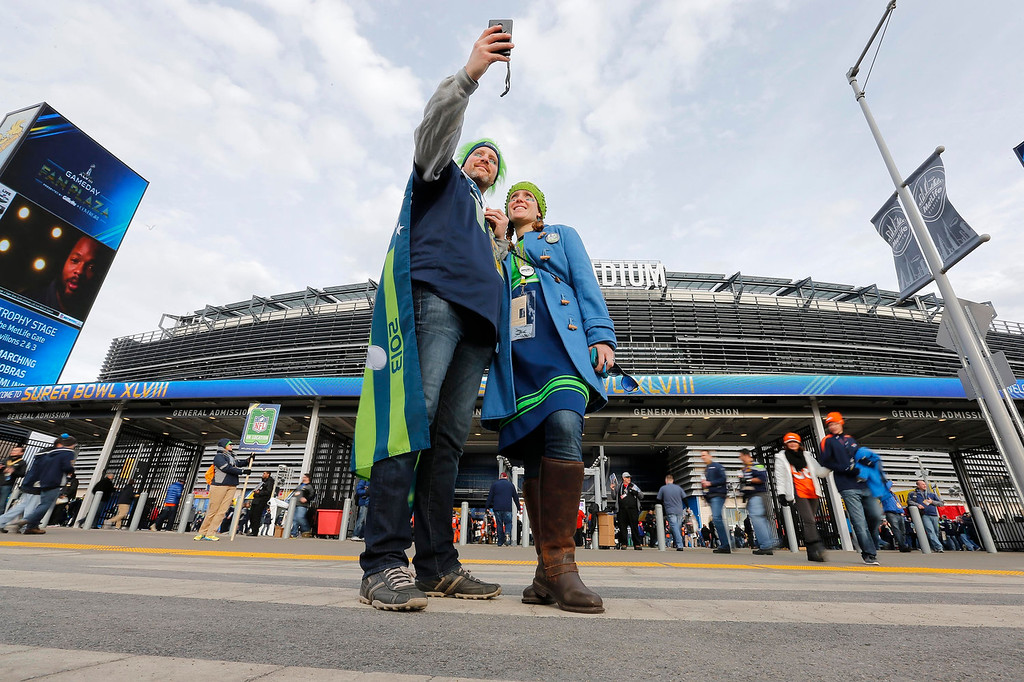. Seattle Seahawks fans Justyn Egert and Candace Henderson, of Seattle, take a selfie outside MetLife Stadium before the NFL Super Bowl XLVIII football game Sunday, Feb. 2, 2014, in East Rutherford, N.J. (AP Photo/Matt York)
