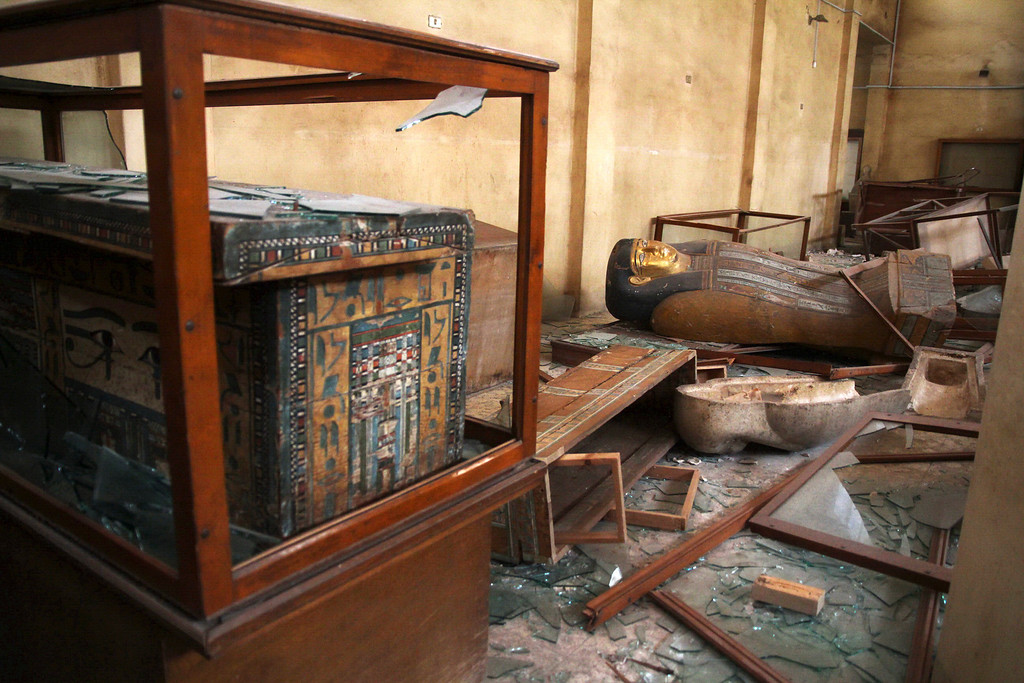 . Damaged pharaonic objects lie on the floor and in broken cases in the Malawi Antiquities Museum after it was ransacked and looted between the evening of Thursday, Aug. 15 and the morning of Friday, Aug. 16, 2013, in Malawi, south of Minya, Egypt, Saturday, Aug. 17, 2013. The interim Cabinet authorized police to use deadly force against anyone targeting police and state institutions on Thursday. The violence capped off a week that saw more than 700 people killed across the country. (AP Photo/Roger Anis, El Shorouk Newspaper)