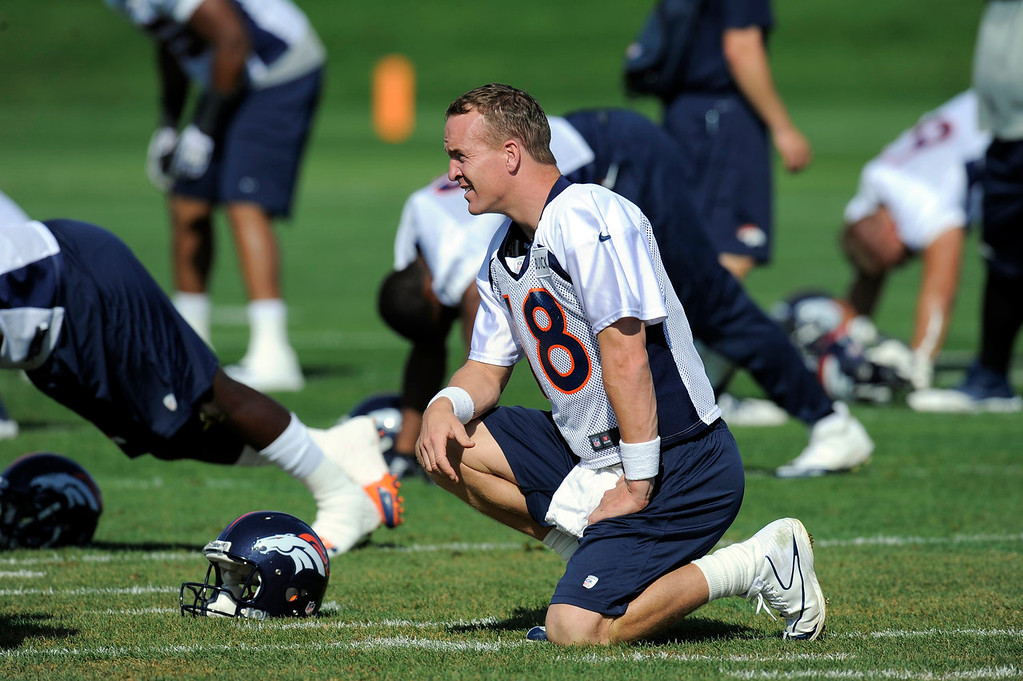 . Denver Broncos quarterback Peyton Manning (18) stretches  during practice September 9, 2013 at Dove Valley. (Photo by John Leyba/The Denver Post)