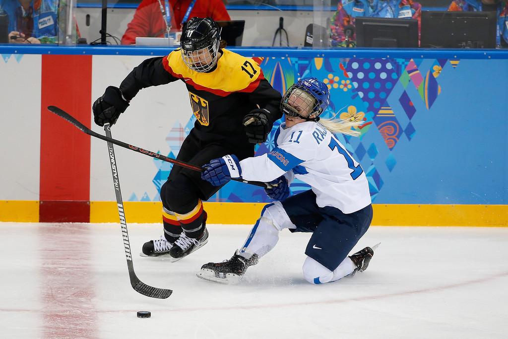 . Annina Rajahuhta of Finland collides with Sara Seiler of Germany during the 2014 Winter Olympics women\'s ice hockey game at Shayba Arena, Sunday, Feb. 16, 2014, in Sochi, Russia. (AP Photo/Petr David Josek)