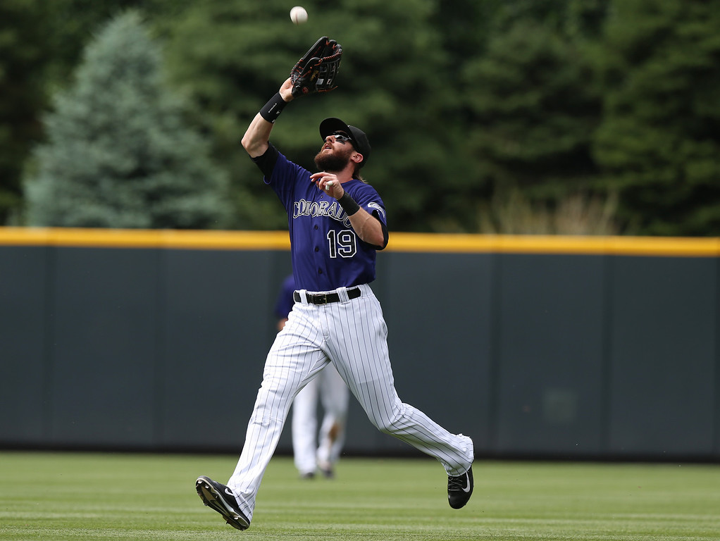 . Colorado Rockies rightfielder Charlie Blackmon hauls in a fly ball off the bat of Los Angeles Dodgers\' Matt Kemp in the fifth inning of a baseball game in Denver on Saturday, June 7, 2014. (AP Photo/David Zalubowski)
