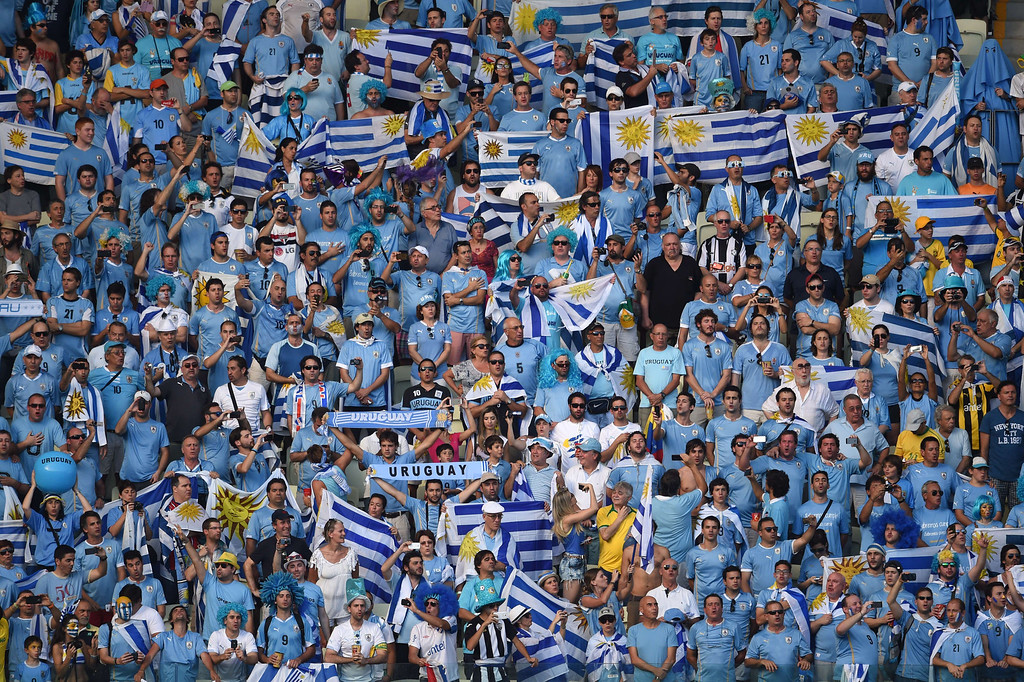 . Fans of Uruguay look on from the stands before a Group D football match between Uruguay and Costa Rica at the Castelao Stadium in Fortaleza during the 2014 FIFA World Cup on June 14, 2014.      AFP PHOTO / CHRISTOPHE SIMON
