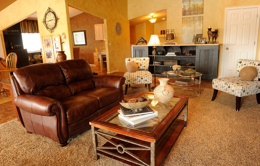 . For the living room, Frances Owens and Barb Tobias scored a leather sofa ($89). (Photo By Cyrus McCrimmon/The Denver Post)