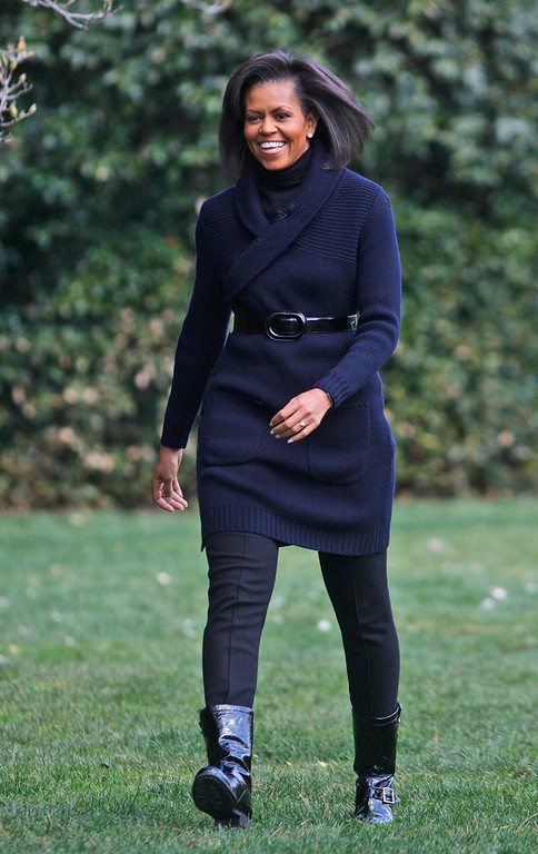 . This March 20, 2009 file photo shows first lady Michelle Obama arriving to take part in the groundbreaking of the White House Kitchen Garden on the South Lawn of the White House in Washington, with students from Washington\'s Bancroft Elementary School. (AP Photo/Ron Edmonds,File)