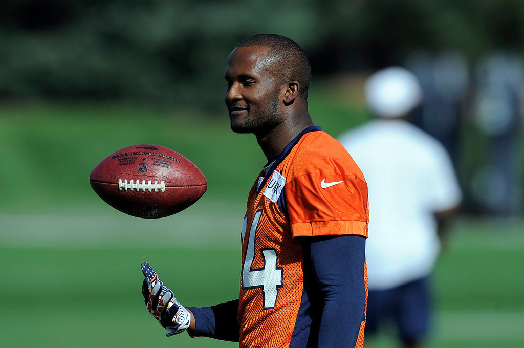 . Denver Broncos cornerback Champ Bailey (24) tosses a football in the air during practice  September 9, 2013 at Dove Valley. (Photo by John Leyba/The Denver Post)