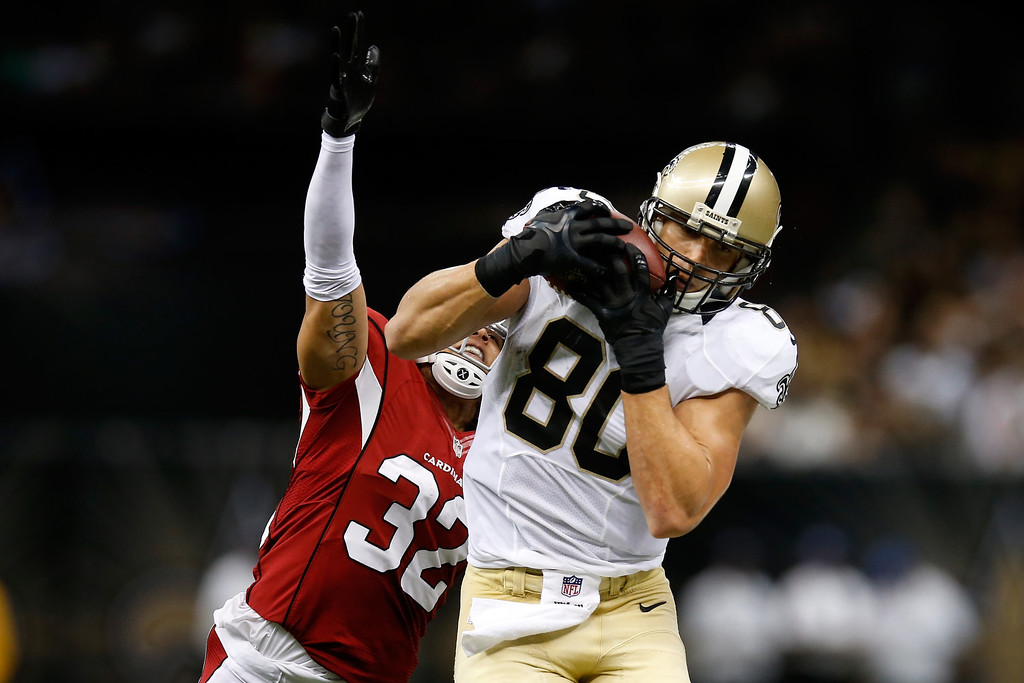 . Jimmy Graham #80 of the New Orleans Saints is tackled by  Tyrann Mathieu #32 of the Arizona Cardinals at the Mercedes-Benz Superdome on September 22, 2013 in New Orleans, Louisiana.  (Photo by Chris Graythen/Getty Images)