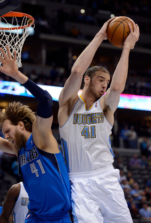 . DENVER, CO. - APRIL 04: Kosta Koufos (41) of the Denver Nuggets hauls down a rebound from Dirk Nowitzki (41) of the Dallas Mavericks during the first quarter April 4,  2013 at Pepsi Center. (Photo By John Leyba/The Denver Post)