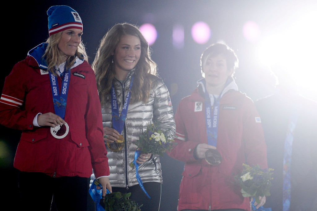 . SOCHI, RUSSIA - FEBRUARY 22: American Mikaela Shiffrin walks across the stage after receiving her gold medal during the ladies\' slalom medals ceremony. Sochi 2014 Winter Olympics on Friday, February 22, 2014 at Sochi Olympic Park. (Photo by AAron Ontiveroz/ The Denver Post)