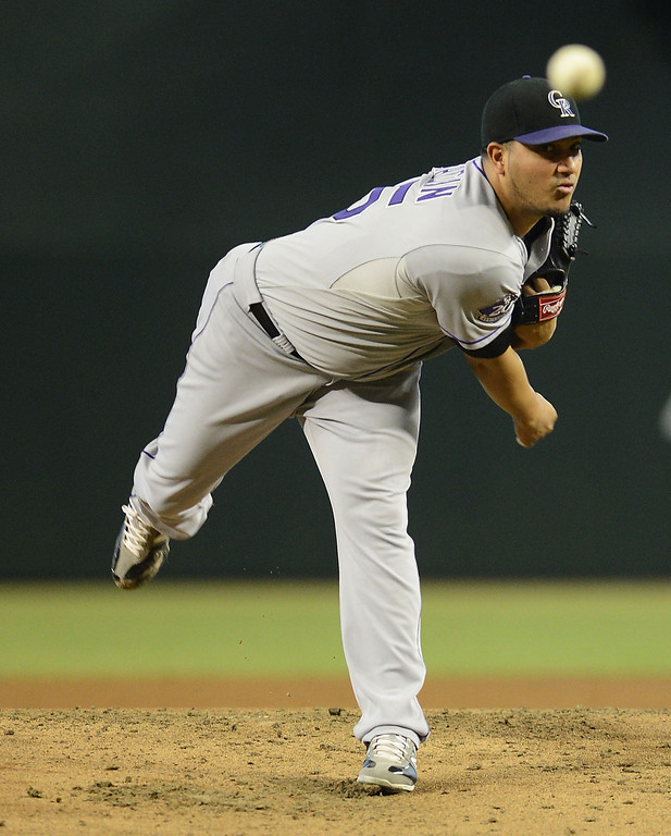 . Starting pitcher Jhoulys Chacin #45 of the Colorado Rockies pitches against the Arizona Diamondbacks in the first inning at Chase Field on September 15, 2013 in Phoenix, Arizona.  (Photo by Jennifer Stewart/Getty Images)