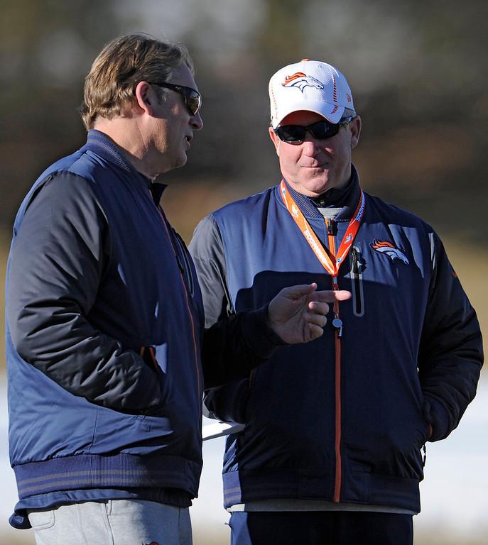 . Denver Broncos defensive coordinator talks with head coach John Fox during  practice Thursday, January 3, 2013 at Dove Valley.  John Leyba, The Denver Post