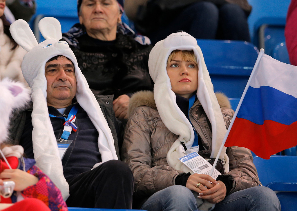 . Spectators wait for the start of the ice dance short dance figure skating competition at the Iceberg Skating Palace during the 2014 Winter Olympics, Sunday, Feb. 16, 2014, in Sochi, Russia. (AP Photo/Vadim Ghirda)