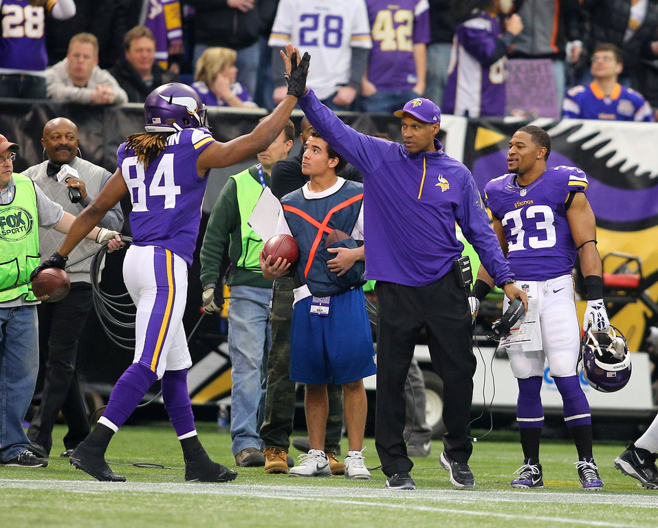 . Cordarrelle Patterson #84 of the Minnesota Vikings celebrates a touchdown with head coach Leslie Frazier of the Minnesota Vikings against the Detroit Lions on December 29, 2013 at Mall of America Field at the Hubert H. Humphrey Metrodome in Minneapolis, Minnesota. (Photo by Adam Bettcher/Getty Images)