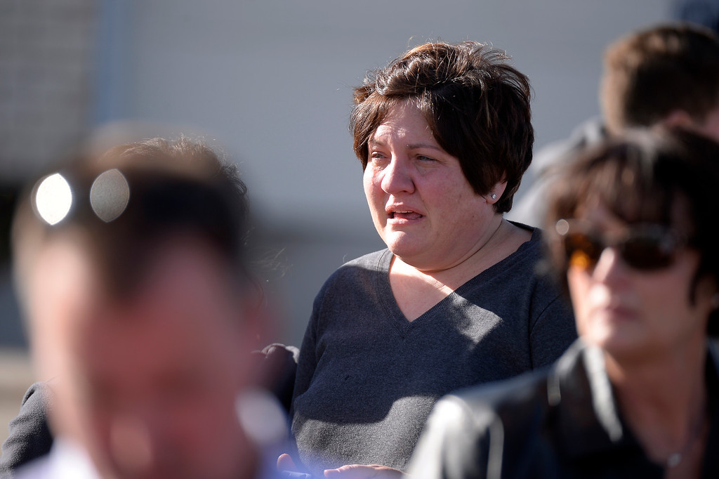 . CENTENNIAL, CO - Arapahoe High School parent sheds tears as she waits to hear word from child as she  stands on the street near the tennis courts. The students were taken to the football field for safety. A gunman was spotted inside Arapahoe High School December 13, 2013. The gunman was targeting a teacher at the school. The gunman shot two students in the process and then turned the gun on himself. DECEMBER 13:  (John Leyba, The Denver Post)