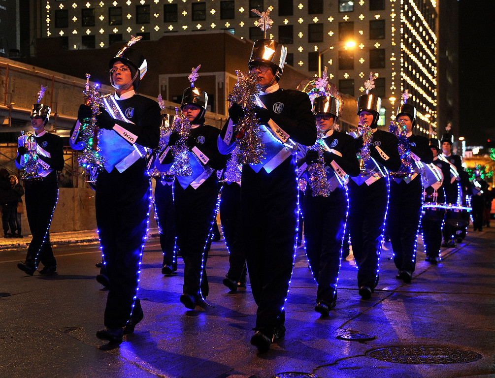 . DENVER, CO. - DECEMBER 06: The Mountain Range High School marching band was illuminated in formation as the 9News Parade of Lights kicked off Friday night, December 6, 2013. The weather was clear but temperatures dipped below zero. Photo By Karl Gehring/The Denver Post
