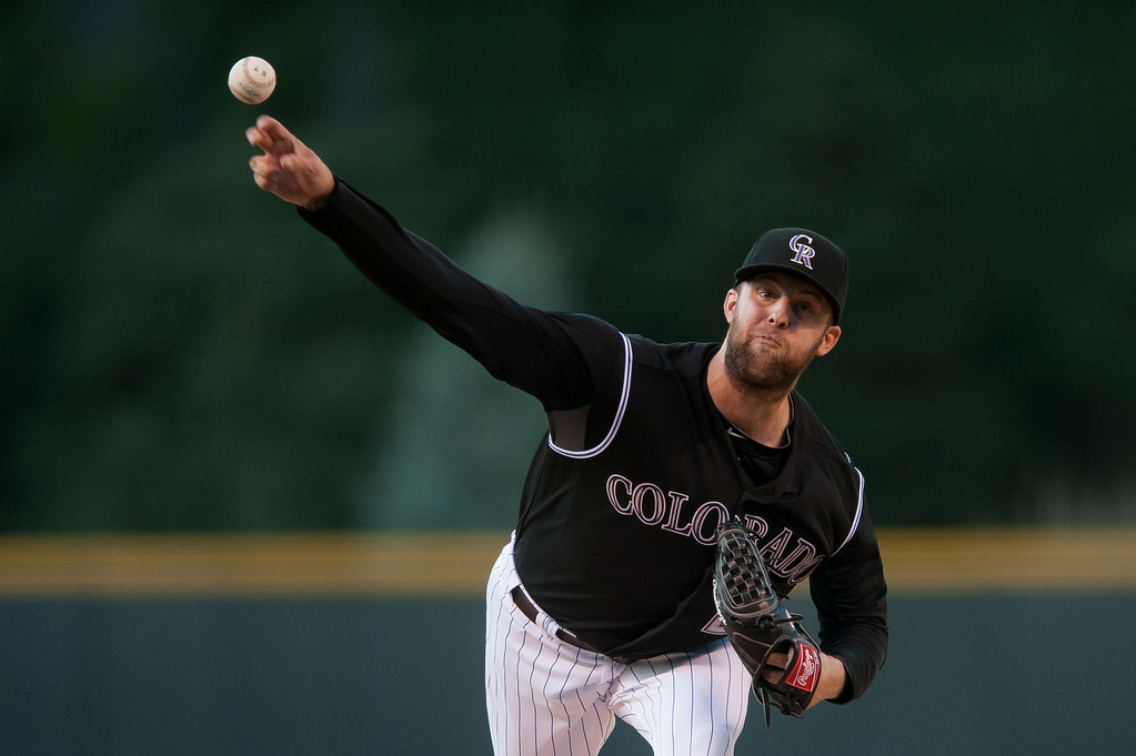 . DENVER, CO - AUGUST 06:  Jordan Lyles #24 of the Colorado Rockies pitches in the first inning of a game against the Chicago Cubs at Coors Field on August 6, 2014 in Denver, Colorado.  (Photo by Dustin Bradford/Getty Images)