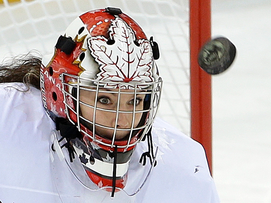 . Goalkeeper Shannon Szabados of Canada looks for the rebound on a blocked shot against Switzerland during the first period of the 2014 Winter Olympics women\'s semifinal ice hockey game at Shayba Arena, Monday, Feb. 17, 2014, in Sochi, Russia. (AP Photo/Matt Slocum)