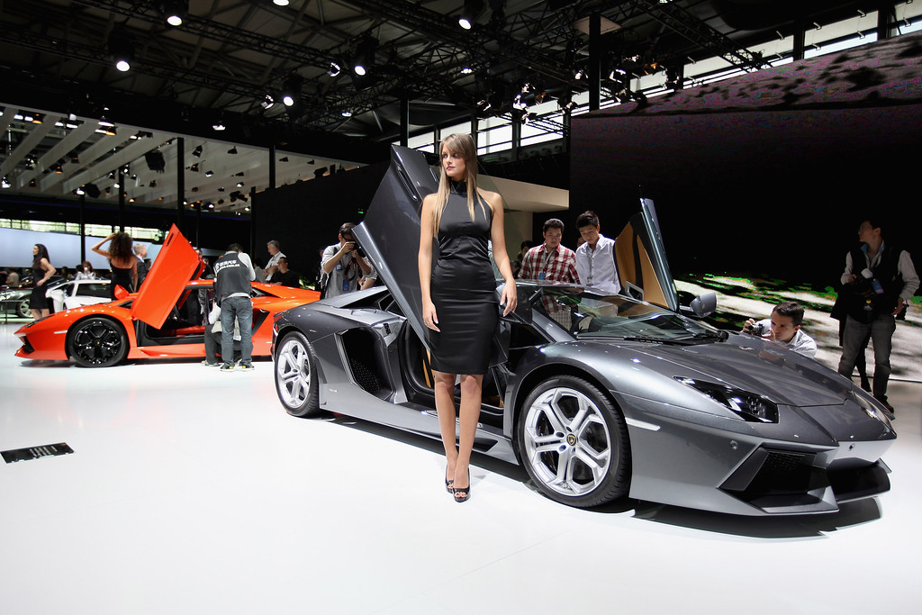 . A model stands beside the Lamborghini Aventador LP700-4 sport car during the media day of the Shanghai International Automobile Industry Exhibition at Shanghai New International Expo Center on April 19, 2011 in Shanghai, China. (Photo by Feng Li/Getty Images)