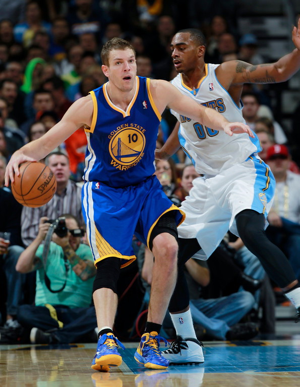 . Golden State Warriors forward David Lee, left, works ball inside against Denver Nuggets forward Darrell Arthur in the fourth quarter of the Warriors\' 89-81 victory in an NBA basketball game in Denver, Monday, Dec. 23, 2013. (AP Photo/David Zalubowski)