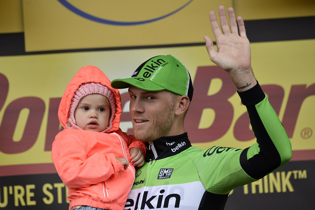 . Stage winner Netherlands\' Lars Boom celebrates on the podium after winning the 152,5 km fifth stage of the 101st edition of the Tour de France cycling race on July 9, 2014 between Ypres, northwestern Belgium, and Arenberg Porte du Hainaut in Wallers northern France.   AFP PHOTO / JEFF P PACHOUD/AFP/Getty Images