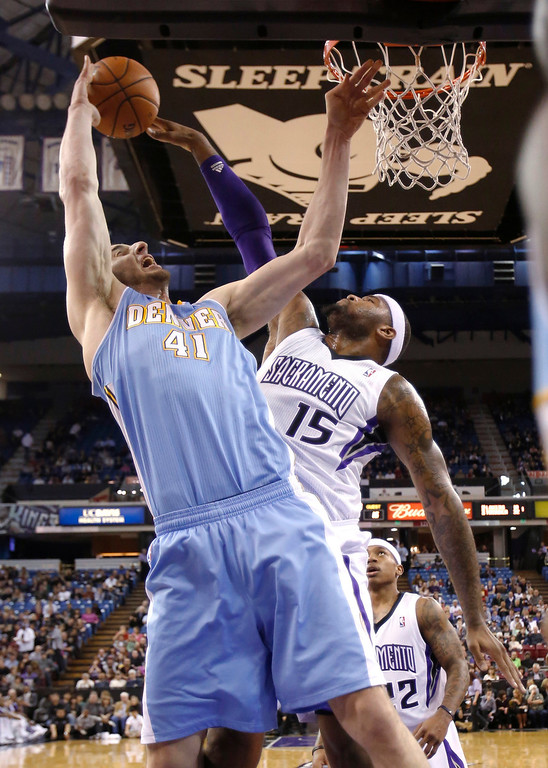 . Sacramento Kings center DeMarcus Cousins, right, blocks the shot of Denver Nuggets center Kosta Koufos during the first quarter of an NBA basketball game in Sacramento, Calif., Tuesday, March 5, 2013. (AP Photo/Rich Pedroncelli)