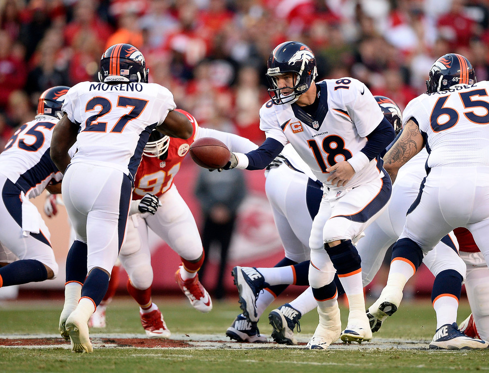 . Denver Broncos quarterback Peyton Manning (18) hands off to Denver Broncos running back Knowshon Moreno (27) during the first quarter against the Kansas City Chiefs December 1, 2013 at Arrowhead Stadium.  (Photo by John Leyba/The Denver Post)