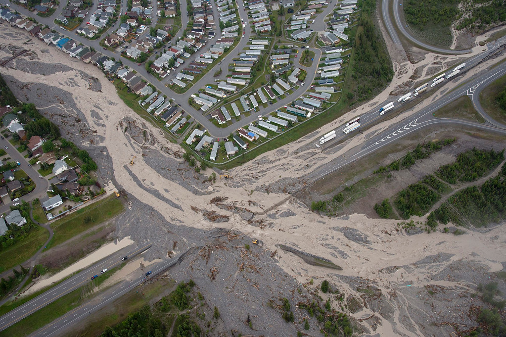 . This aerial photo shows Cougar Creek runing through the Trans Canada Highway during heavy floods in Canmore, Alberta, Canada, on Friday June 21, 2013.   (AP Photo/The Canadian Press, Jonathan Hayward)