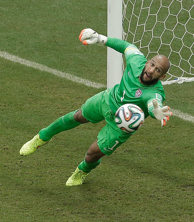 . United States\' goalkeeper Tim Howard can\'t stop a shot by Germany\'s Thomas Mueller during the group G World Cup soccer match between the USA and Germany at the Arena Pernambuco in Recife, Brazil, Thursday, June 26, 2014. Mueller scored on the play. (AP Photo/Hassan Ammar)
