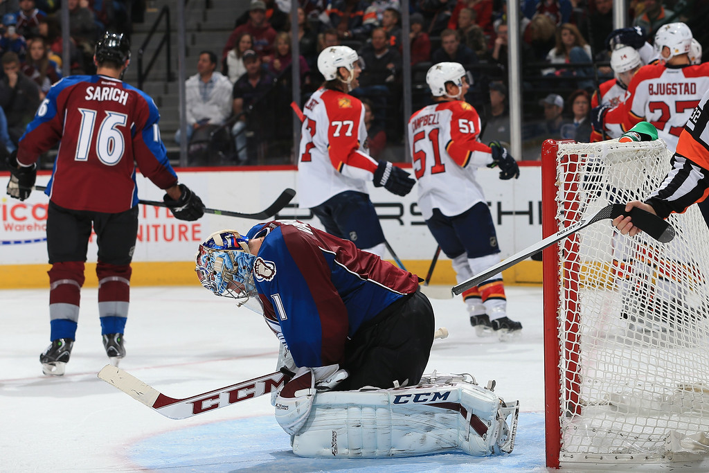 . DENVER, CO - NOVEMBER 16:  Goalie Semyon Varlamov #1 of the Colorado Avalanche reacts as the Florida Panthers celebrate a goal by Jonathan Huberdeau #11 of the Florida Panthers in the third period at Pepsi Center on November 16, 2013 in Denver, Colorado. The Panthers defeated the Avalanche 4-1.  (Photo by Doug Pensinger/Getty Images)