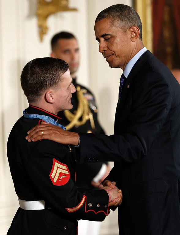 . Retired Marine Cpl. William \'Kyle\' Carpenter is greeted by U.S. President Barack Obama after receiving the Medal of Honor during a ceremony in the East Room of the White House on June 19, 2014 in Washington, DC.  (Photo by Win McNamee/Getty Images)