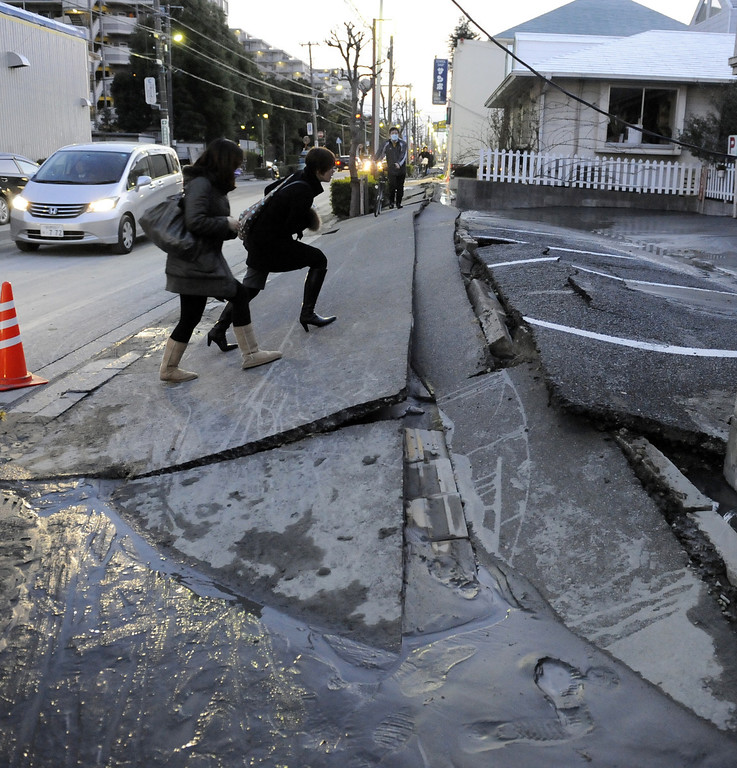. A pedestrian road has collapsed in the massive 8.9-magnitude earthquake in Urayasu city, Chiba prefecture on March 11, 2011. The earthquake shook Japan, unleashing powerful tsunamis that sent ships crashing into the shore and carried cars through the streets of coastal towns. (TOSHIFUMI KITAMURA/AFP/Getty Images)