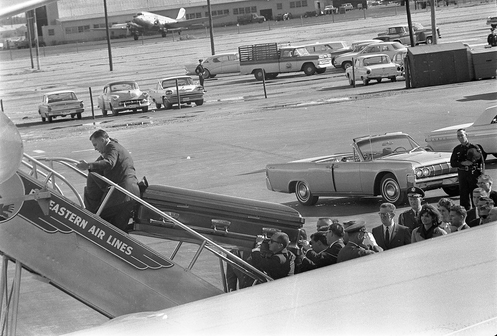 ". President Kennedy\'s casket is loaded onto Air Force One at Love Field in Dallas. Onlookers include Lawrence ""Larry\"" O\'Brien, Jacqueline Kennedy and Dave Powers. Cecil Stoughton/John F. Kennedy Presidential Library and Museum"