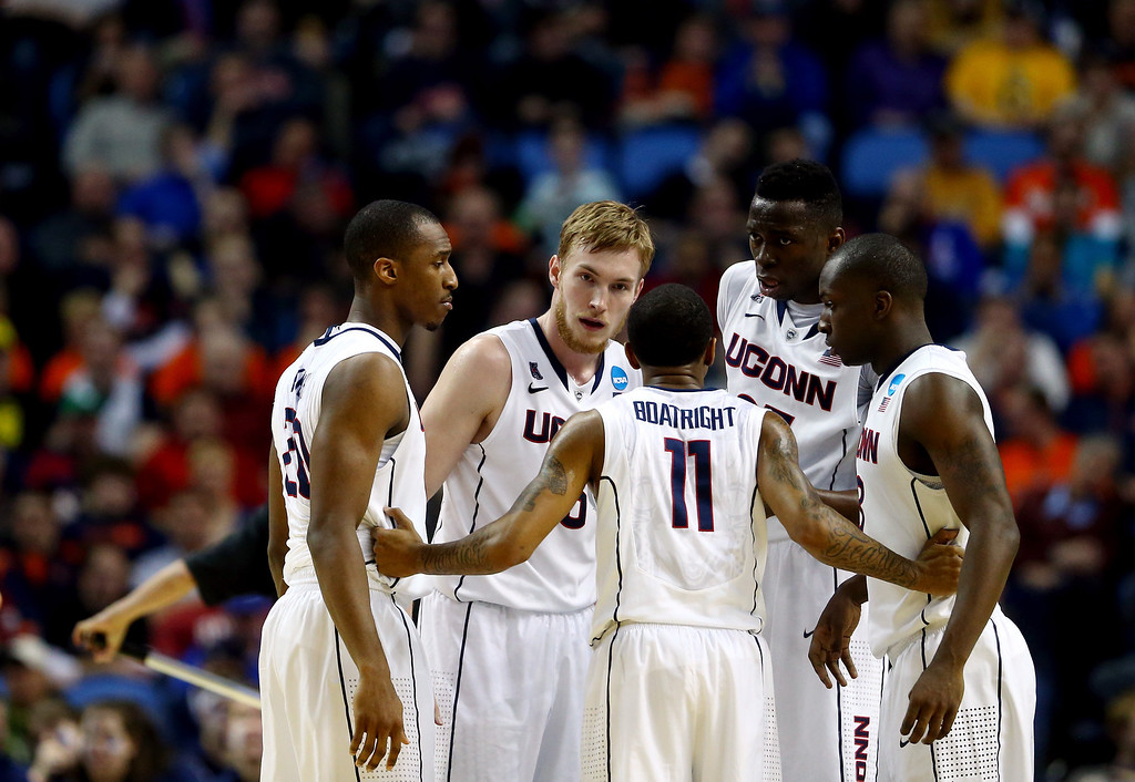 . BUFFALO, NY - MARCH 20:  The Connecticut Huskies huddle during the second round of the 2014 NCAA Men\'s Basketball Tournament against the Saint Joseph\'s Hawks at the First Niagara Center on March 20, 2014 in Buffalo, New York.  (Photo by Elsa/Getty Images)