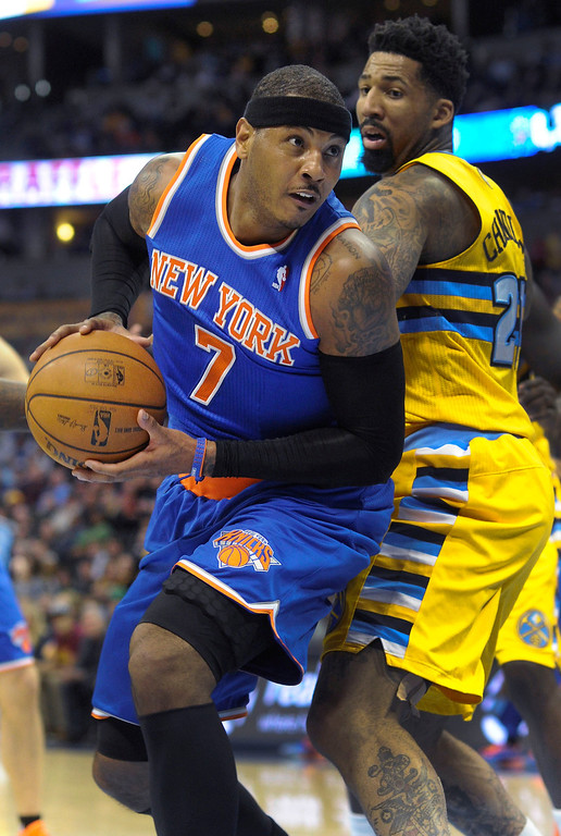 . Knicks forward Carmelo Anthony (7) made a move past Denver forward Wilson Chandler (21) in the first half.    Photo By Karl Gehring/The Denver Post
