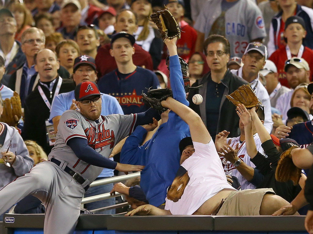 . National League All-Star Freddie Freeman #5 of the Atlanta Braves tries to make a catch against the American League All-Stars during the 85th MLB All-Star Game at Target Field on July 15, 2014 in Minneapolis, Minnesota.  (Photo by Elsa/Getty Images)