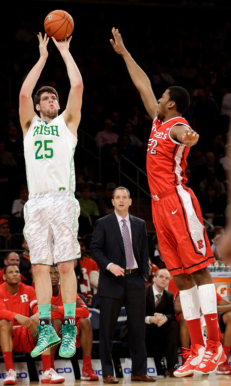 . Notre Dame\'s Tom Knight (25) shoots over Rutgers\' Kadeem Jack (22) during the first half of an NCAA college basketball game at the Big East Conference tournament, Wednesday, March 13, 2013, in New York. (AP Photo/Frank Franklin II)