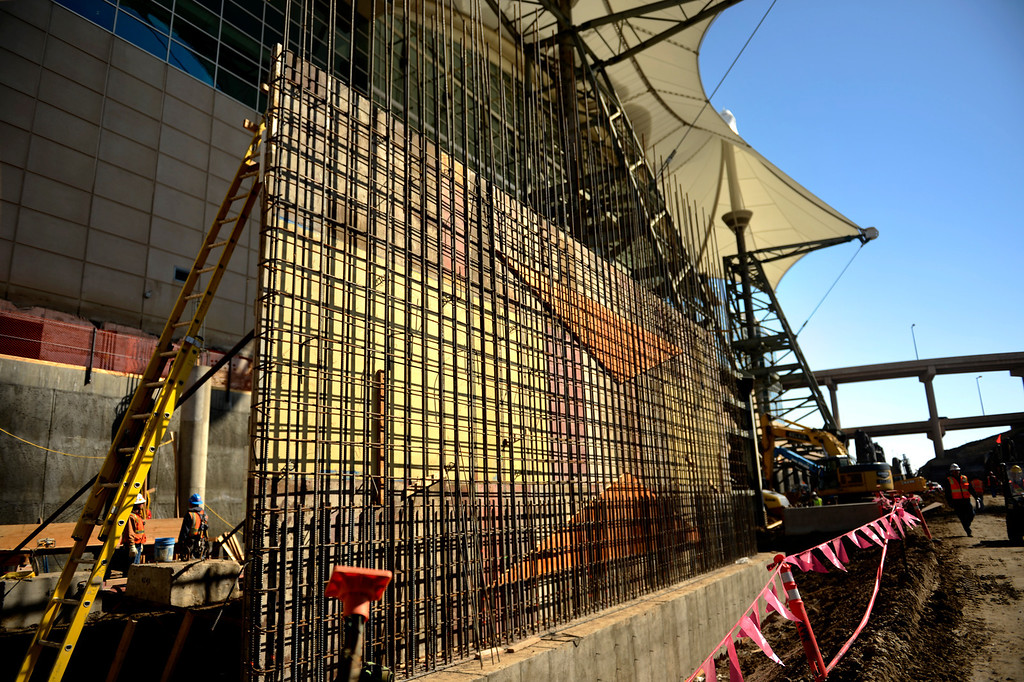 . A sheer wall being build that will hook into the main hotel as the Denver International Airport South Terminal Redevelopment Program is now starting to build vertical and the Westin Hotel and conference center is beginning to take shape. March 27, 2013 Denver, Colorado. (Photo By Joe Amon/The Denver Post)