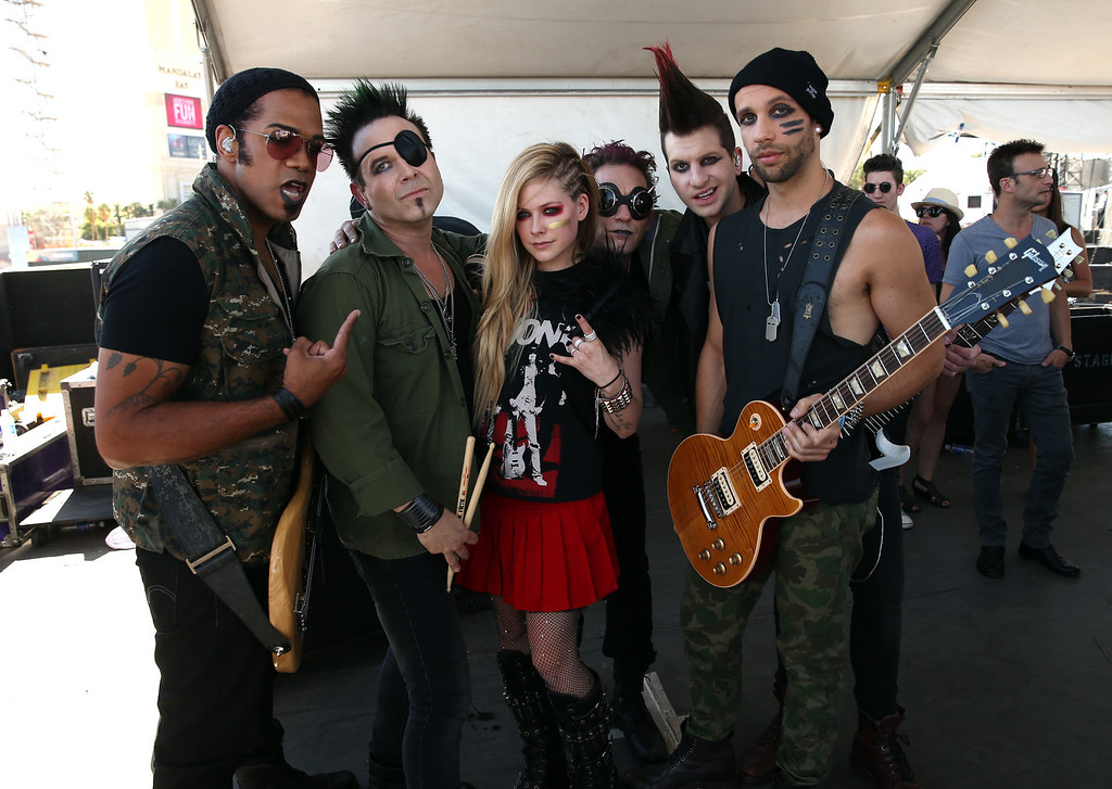 . Singer Avril Lavigne (C) poses with her band during the iHeart Radio Music Festival Village on September 21, 2013 in Las Vegas, Nevada.  (Photo by Christopher Polk/Getty Images for Clear Channel)