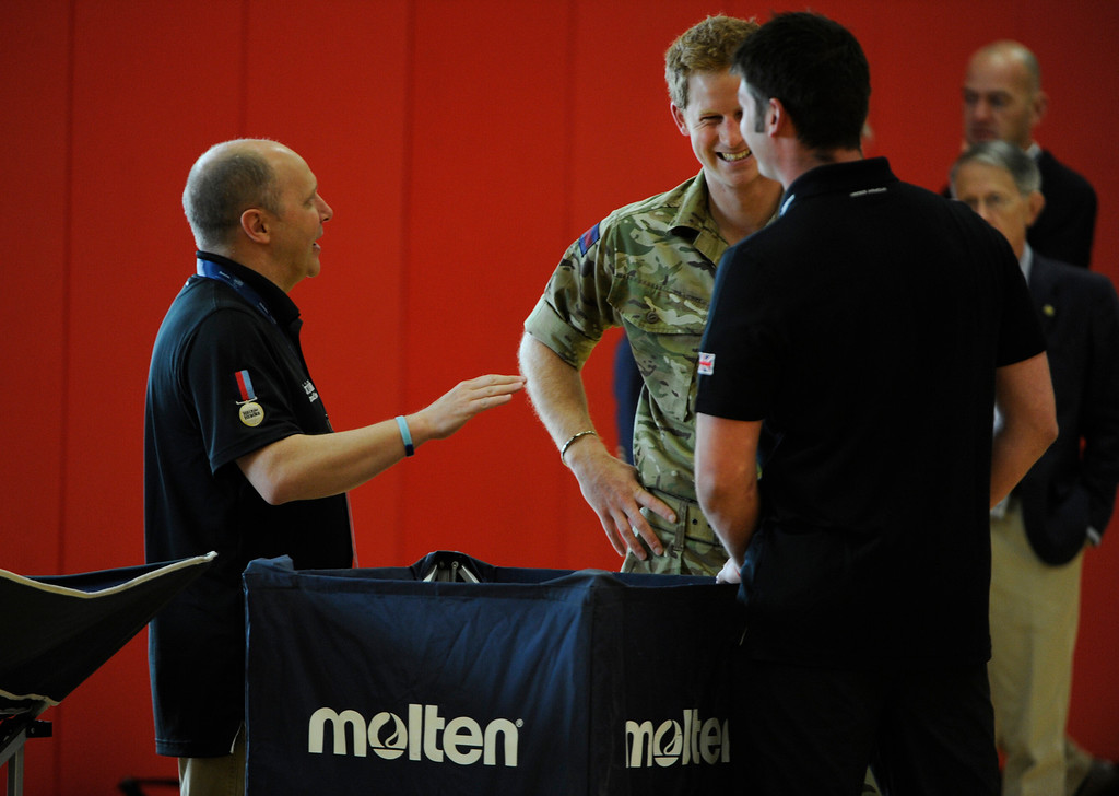 . COLORADO SPRINGS, CO - MAY 11: Britain\'s Prince Harry, center, talks and has a laugh with British Armed Forces team leader/coach, Martin Colclough, left, and athlete, Capt. Dave Hensen, right,  greets Capt. Dave Hensen, right, at the United States Olympic Training Center  for the 2013 Warrior Games Saturday morning, May 11th, 2013. British Armed Forces team leader/coach, Martin Colclough, left, makes introductions. (Photo By Andy Cross/The Denver Post)