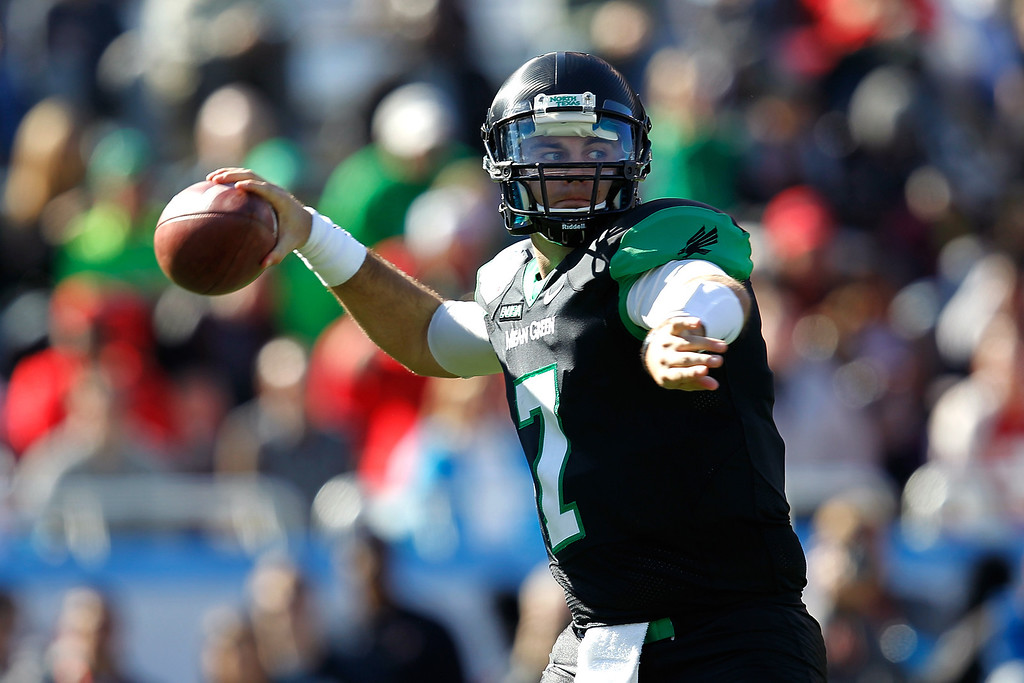 . DALLAS, TX - JANUARY 01: Derek Thompson #7 of the North Texas Mean Green looks to pass against the UNLV Rebels during the Heart of Dallas Bowl at Cotton Bowl Stadium on January 1, 2014 in Dallas, Texas.  (Photo by Sarah Glenn/Getty Images)