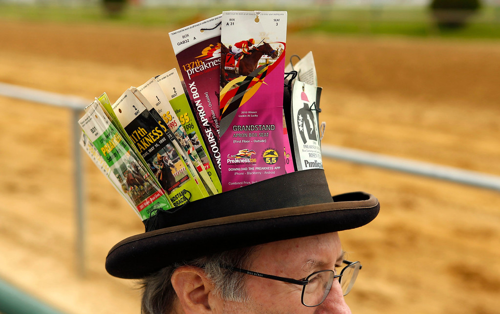 . Wearing a hat with his tickets from 35 years of viewing, Kevin Corcoran of Moorestown, N.J., looks out at the track prior to the 138th running of the Preakness Stakes at Pimlico Race Course in Baltimore, Maryland May 18, 2013.   REUTERS/Kevin Lamarque