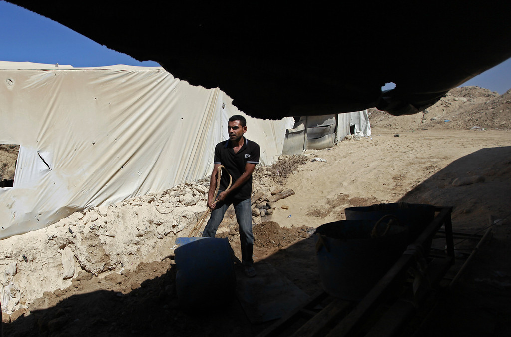 . In this Monday, Sept. 30, 2013 photo, a Palestinian works outside a tunnel in Rafah, on the border between Egypt and the southern Gaza Strip. Since the summer, Egypt�s military has tried to destroy or seal off most of the smuggling tunnels under the Gaza-Egypt border, a consequence of the heightened tensions between Cairo and the Hamas government in Gaza. (AP Photo/Hatem Moussa)