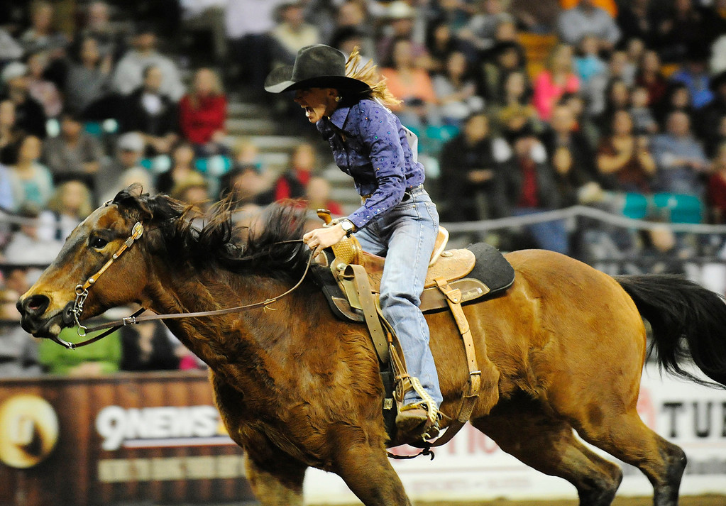 . Pamela Capper of Cheney, WA competes in the barrel race competition during the U.S. Bank Pro Rodeo Finals, at the National Western Stock Show in Denver, CO, Sunday, January 26, 2014. Sunday was the final day of the event.  (Photo By Brenden Neville / Special to The Denver Post)