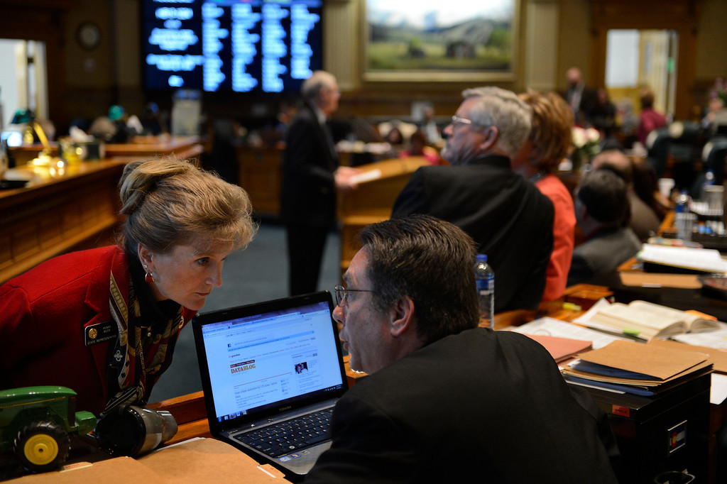. DENVER, CO. - FEBRUARY 15: Representative Perry Buck talks to Representative Jerry Sonneberg as the House debates HB 1224 prohibiting large capacity ammunition magazines at the Denver State Capitol February 15, 2013. Denver, Colorado. (Photo By Joe Amon/The Denver Post)
