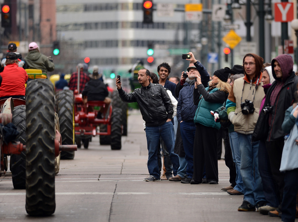 . People taking photo of 107th National Western Stock Show Kick-Off Parade at Downtown Denver on Thursday. Denver, CO, January 10, 2013.  Hyoung Chang, The Denver Post